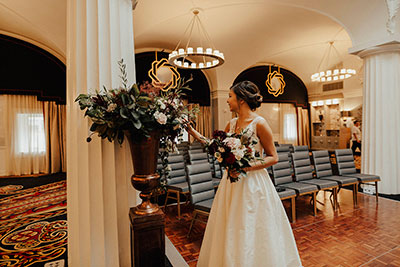 Bride with flowers in wedding venue